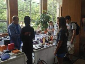 Students survey the headphones on display