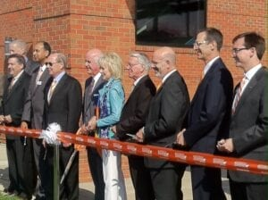John Tickle, Chancellor Cheek, and others cut the ribbon to officially open the building.
