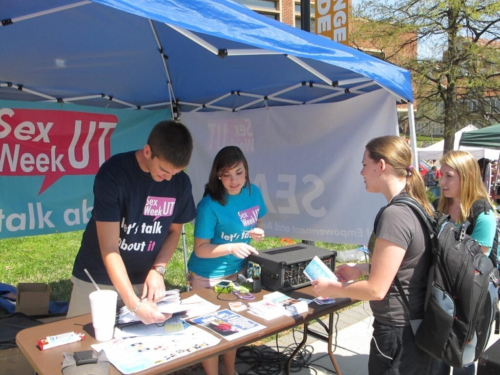 In 2013, volunteers helped promote Sex Week by passing out stickers, programs and health pamphlets on Pedestrian Walkway.