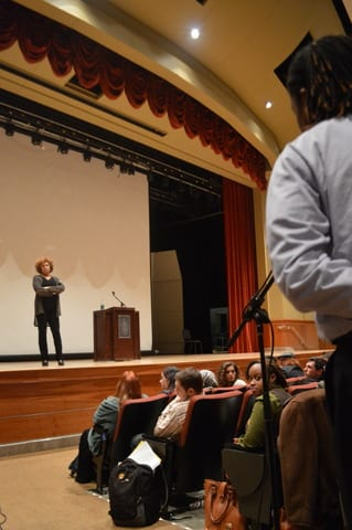Renski Davis-Buckley, UT graduate student, leans in to pose a challenging question to visiting speaker Angela Davis.