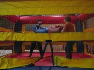 Two students playfully battle it out in the bounce house.  Danyell Luster/ TNJN