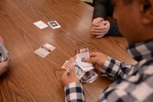 The card game creates a test for students to critically think rather than just memorize a bunch of facts. Photo by Ryan McGill.