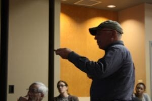 Paleontologist Don Goldstein speaks to a crowd Friday at the UT Science Forum.