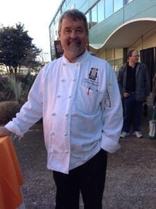 UT Culinary Director Greg Eisele helping and observing students during the ice carving event