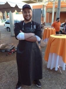 UT Culinary Arts student Joseph Cakmes after finishing his dolphin ice carving.