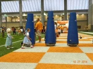 """""""Dorothy"""" runs the football obstacle course."""