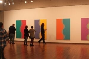 Students look at the Color Refined exhibit located in the Ewing Gallery in the Art & Architecture building.