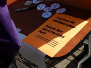 """Event organizer Corey Hodge said that he printed 250 copies of the signs used during """"Break the Silence."""""""