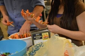 Students try their hand at making paneer tikka.