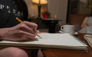 John never leaves his apartment without a pencil and his sketchbook. Ryan McGill//TNJN