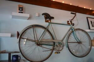 A bicycle hangs on the wall at Blue Mason Coffeehouse. //Photo by Katy Hill