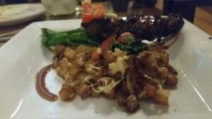 Filet on a stick small plate paired with broccolini and cubed potatoes.//Photo by Jessica Carr