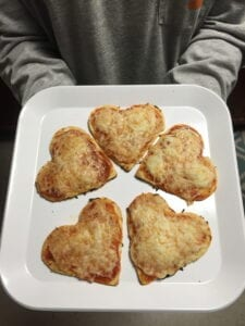These adorable heart-shaped pizzas will make the perfect Valentine's Day dinner. //Photo by Alley Loope
