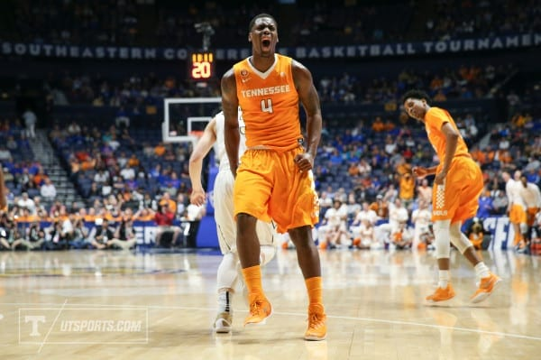 NASHVILLE,TN - MARCH 10, 2016 - Forward Armani Moore #4 of the Tennessee Volunteers celebrates during the SEC Basketball Tournament game between the Vanderbilt Commodores and the Tennessee Volunteers at Bridgestone Arena in Nashville, TN. Photo By Craig Bisacre/Tennessee Athletics
