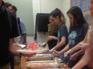 Culture Week participants serve Yassin's food to attendees at the UT International House March 28, 2017.