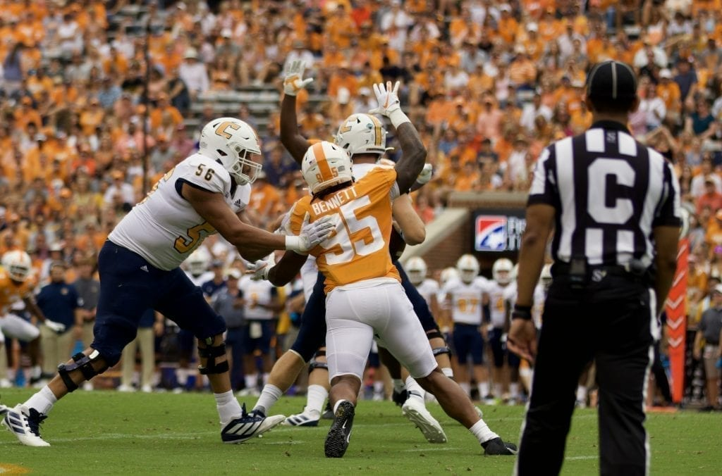Tennessee linebacker Kivon Bennett #95 chases after Chattanooga quarterback Nick Tiano #7 in Neyland Stadium on Sept. 14, 2019 in Knoxville, Tennessee. Photo/ Ben Gleason
