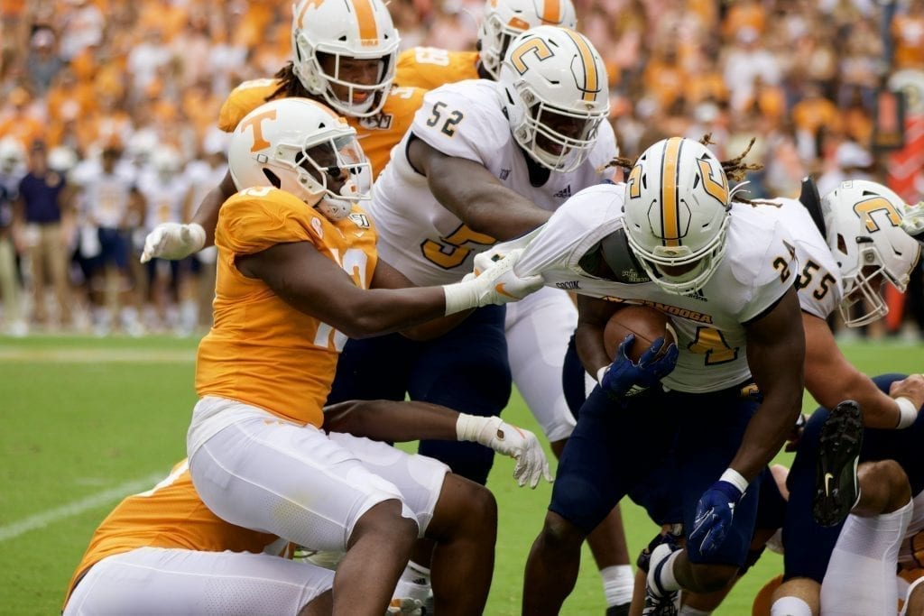 Tennessee linebacker Deandre Johnson #13 pulls down Chattanooga running back Elijah Ibitokun-Hanks #24 in Neyland Stadium on Sept. 14, 2019 in Knoxville, Tennessee. Photo/ Ben Gleason