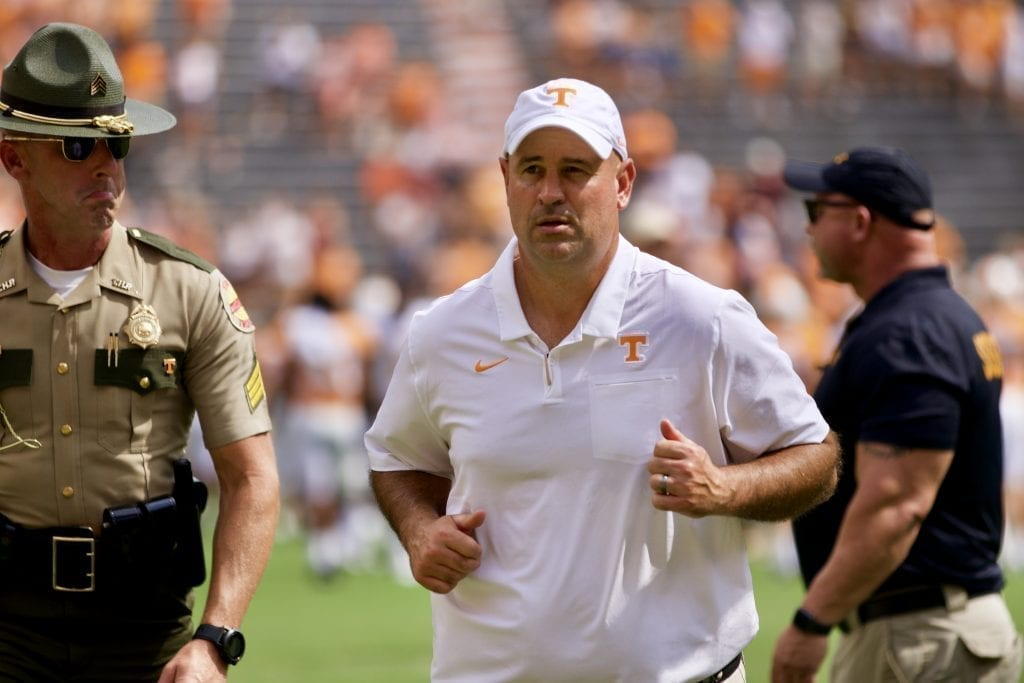 Tennessee head coach Jeremy Pruitt runs off the field after a win versus Chattanooga in Neyland Stadium on Sept. 14, 2019 in Knoxville, Tennessee. Photo/ Ben Gleason