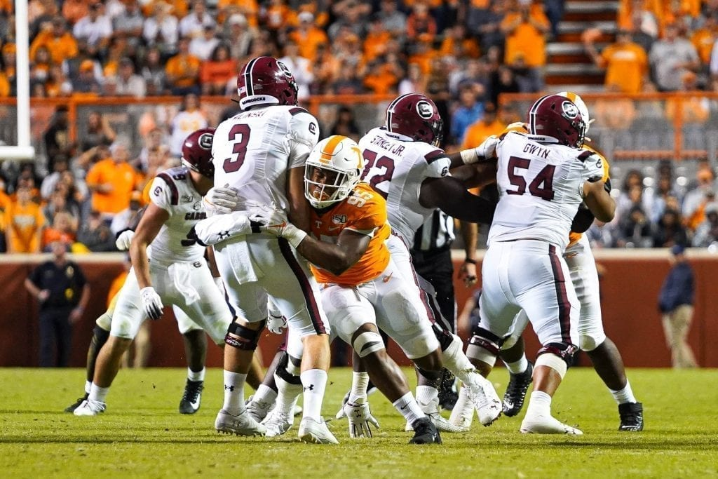 Defensive lineman John Mincey lays a hit on quarterback Ryan Hilinski (3) when Tennessee played South Carolina in Neyland Stadium on October 27, 2019. Photo/ Ben Gleason