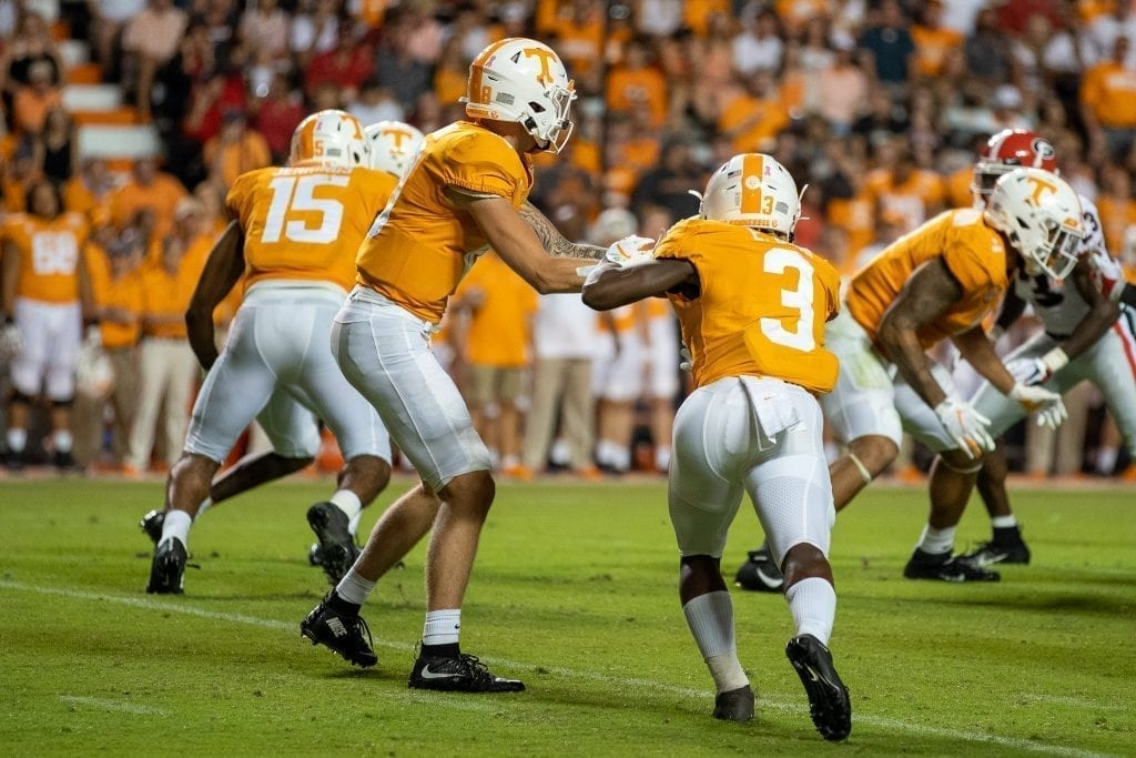Eric Gray #3 takes a handoff from Brian Maurer #18 when Tennessee played Georgia in Neyland on Oct. 5. Photo/ Ben Gleason