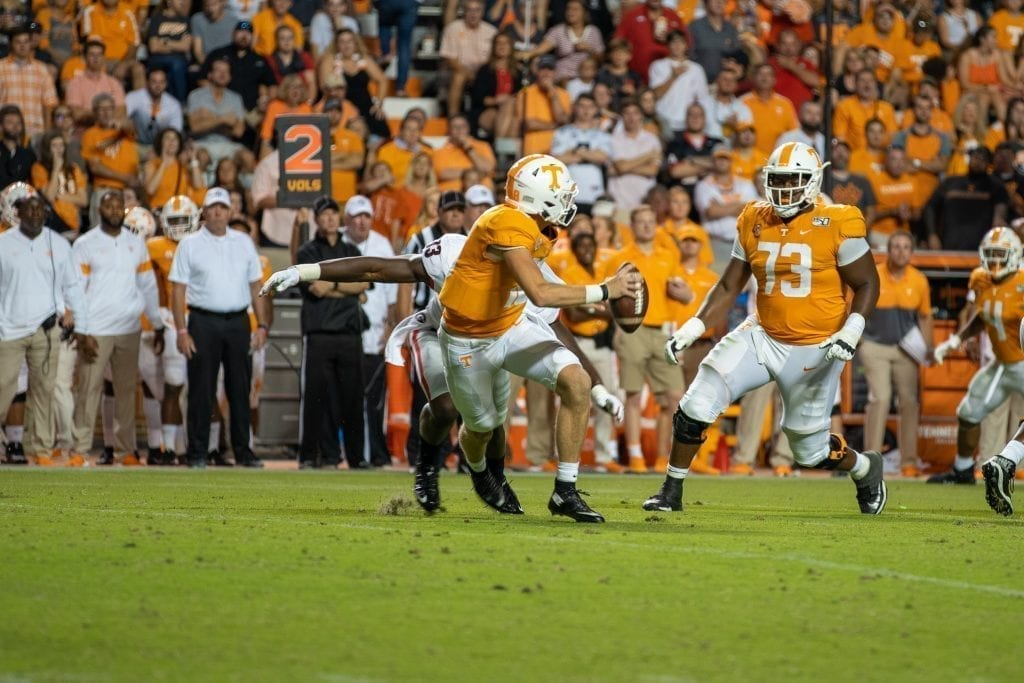 Quarterback Brian Maurer tries to escape pressure when Tennessee played Georgia in Neyland on Oct. 5. Photo/ Ben Gleason