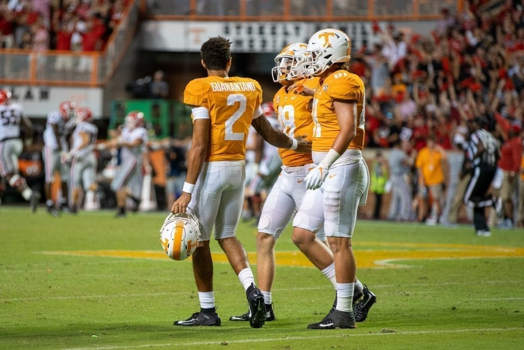 Jarret Guarantano walks Brian Maurer off the field in the 4th quarter when Tennessee played Georgia in Neyland on Oct. 5. Photo/ Ben Gleason