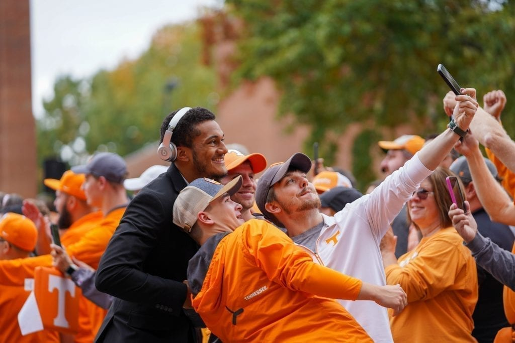 Tennessee players pose with fans during the Vol Walk when Tennessee played South Carolina in Neyland Stadium on October 27, 2019. Photo/ Ben Gleason
