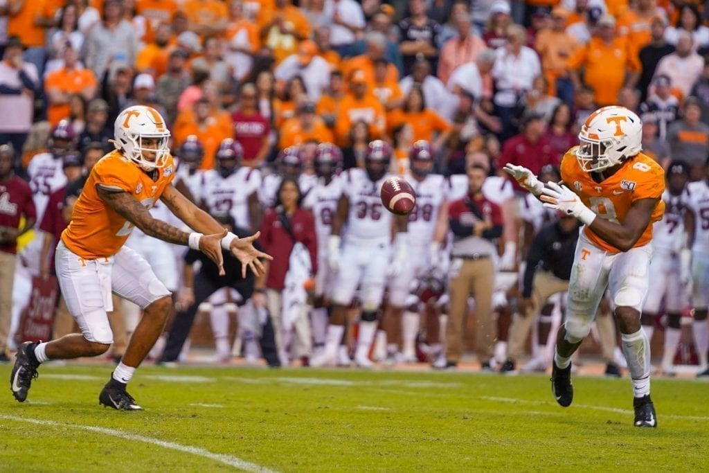 Quarterback Jarrett Guarantano (2) pitches the ball to runningback Ty Chandler (8) when Tennessee played South Carolina in Neyland Stadium on October 27, 2019. Photo/ Ben Gleason