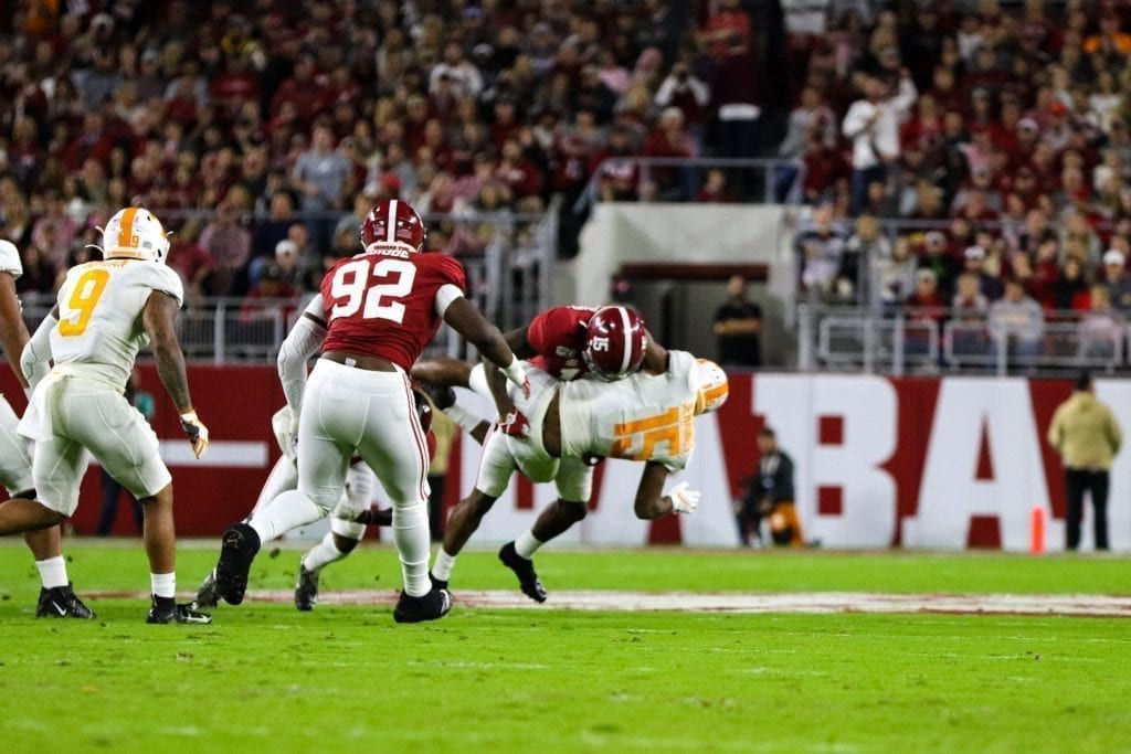 Alabama defensive back Xavier McKinney (15) tackles Tennessee wide receiver Jauan Jennings (15) when Tennessee played Alabama in Tuscaloosa on Oct. 19, 2019. Photo/ Ben Gleason
