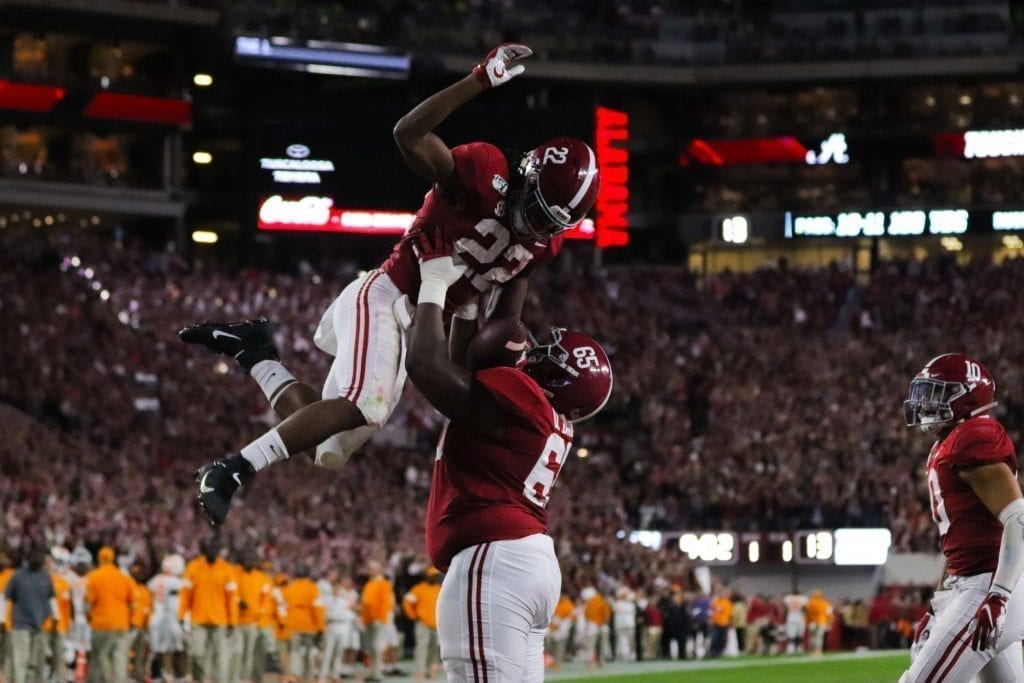 Alabama running back Najee Harris (22) celebrates a touchdown with teammate Deonte Brown (65) when Tennessee played Alabama in Tuscaloosa on Oct. 19, 2019. Photo/ Ben Gleason