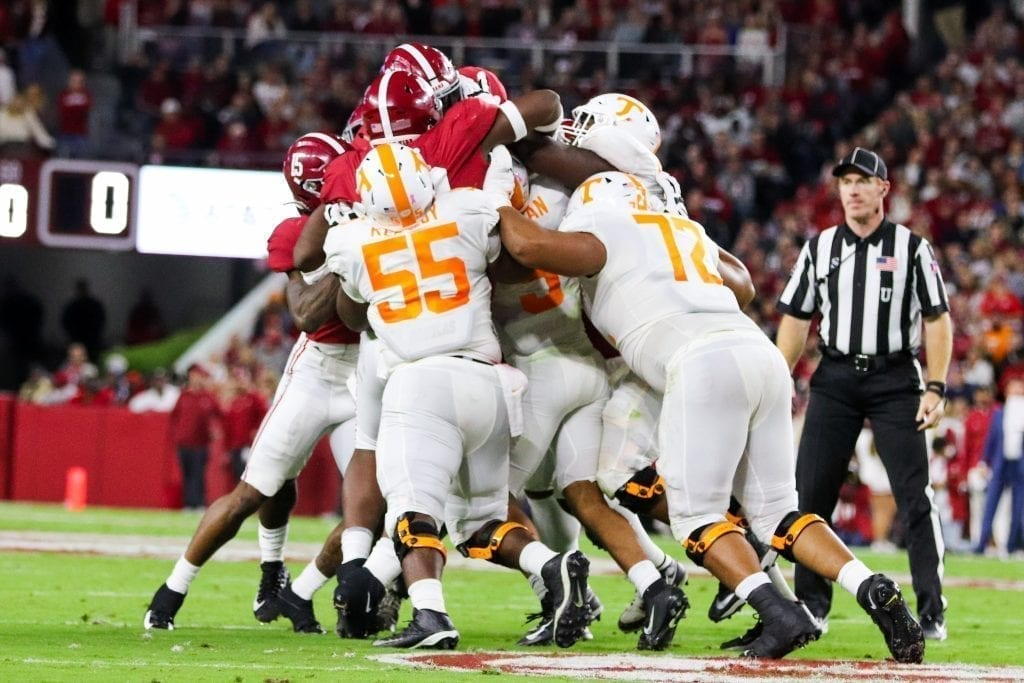 The Tennessee offensive line pushes running back Tim Jordan (9) forward when Tennessee played Alabama in Tuscaloosa on Oct. 19, 2019. Photo/ Ben Gleason