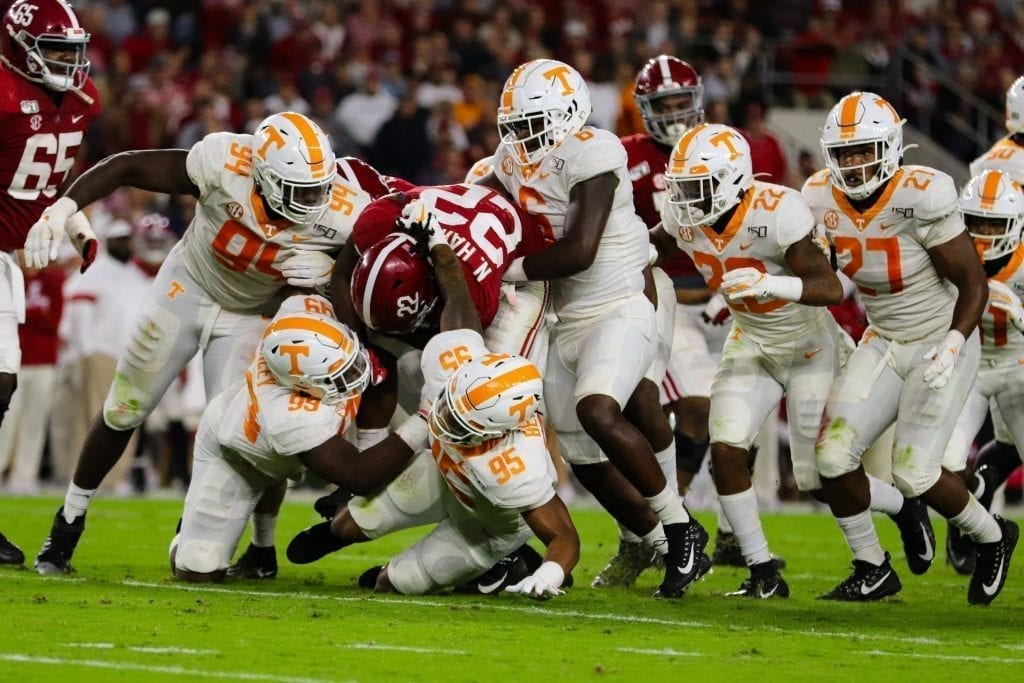 The Tennessee defensive swarm tackles Alabama running back Najee Harris (22) when Tennessee played Alabama in Tuscaloosa on Oct. 19, 2019. Photo/ Ben Gleason
