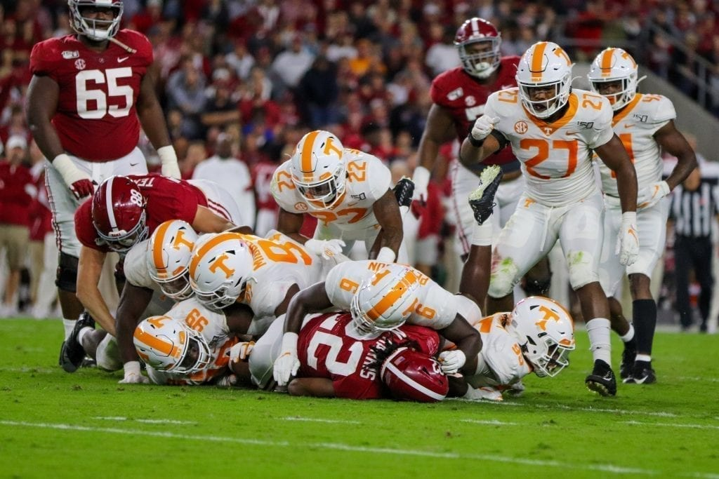 Tennessee defensive players tackle Alabama running back Najee Harris (22) when Tennessee played Alabama in Tuscaloosa on Oct. 19, 2019. Photo/ Ben Gleason