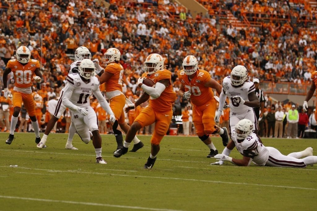 Tim Jordan (9) charges towards the end zone in Neyland on Oct. 12. Photo/Ben Gleason