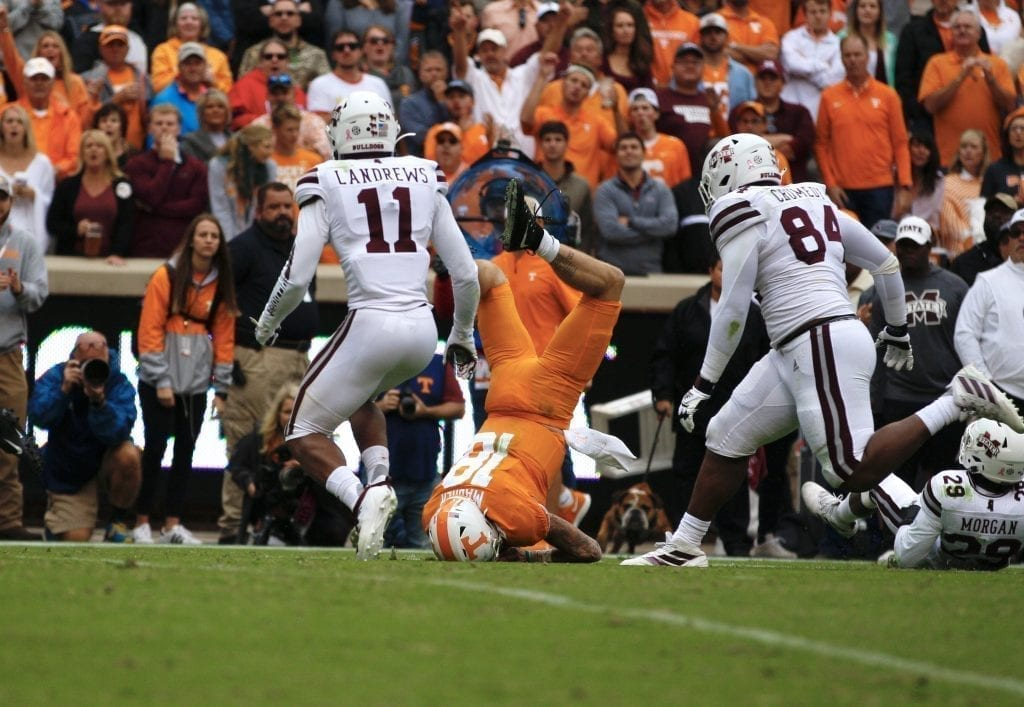 Brian Maurer (18) is flipped onto his head when Tennessee played Mississippi State in Neyland on Oct. 12. Photo/Ben Gleason