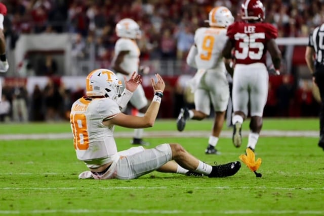 Quarterback Brian Maurer (18) falls to the ground after being hit when Tennessee played Alabama in Tuscaloosa on Oct. 19, 2019. Photo/ Ben Gleason