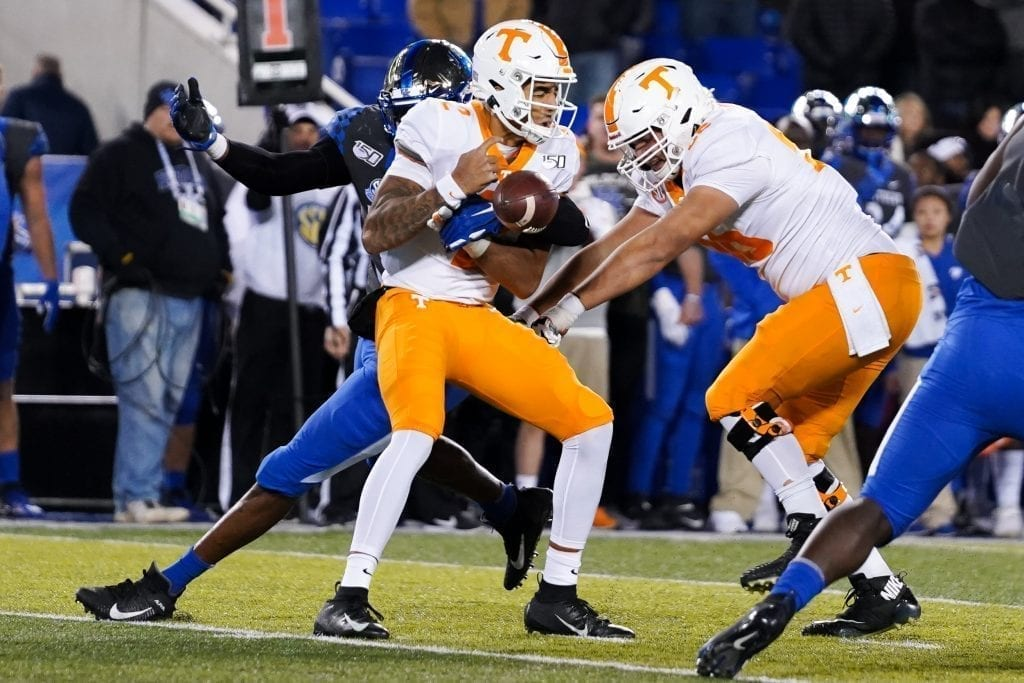 Tennessee quarterback Jarrett Guarantano (2) gets hit and looses the ball when Tennessee played Kentucky in Kroger Field on November 9, 2019. Photo/ Ben Gleason