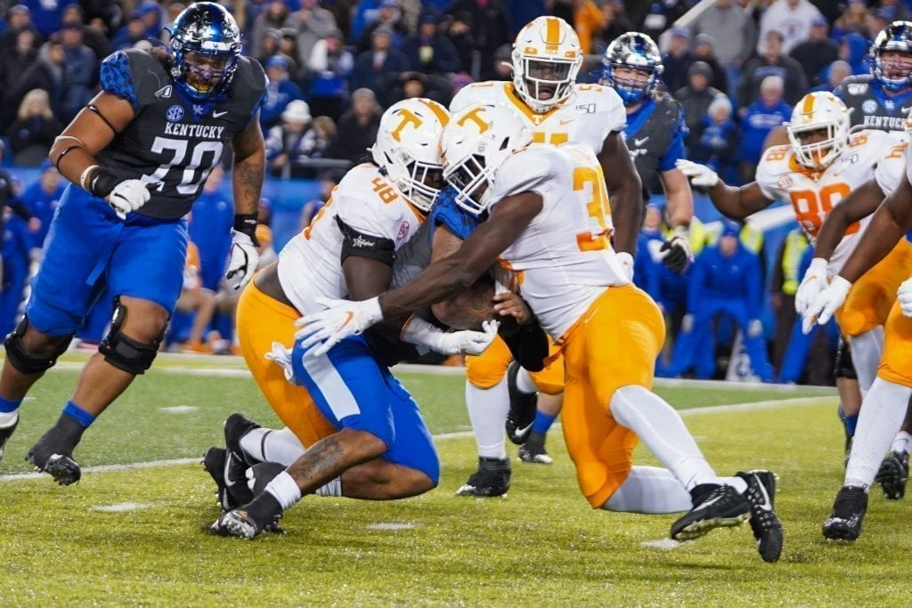 Tennessee defensive lineman Ja'Quain Blakely (48) and linebacker Daniel Bituli (35) tackle a Kentucky ball carrier on fourth down when Tennessee played Kentucky in Kroger Field on November 9, 2019. Photo/ Ben Gleason