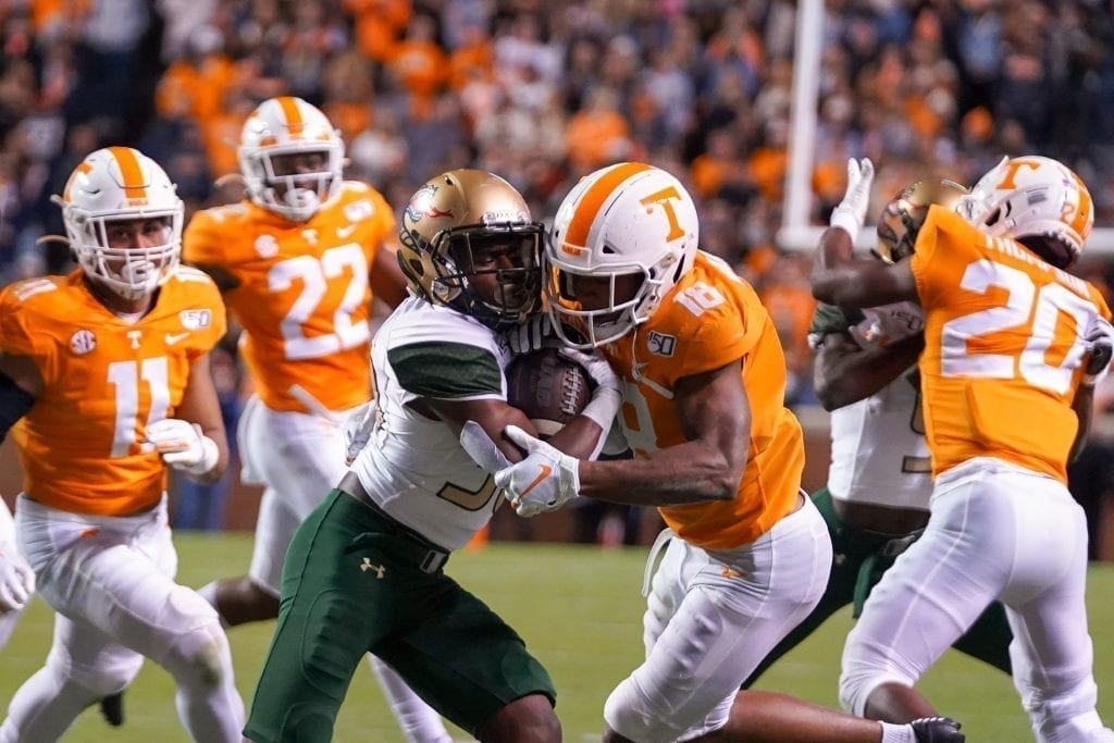Tennessee defensive back Nigel Warriors collides with a UAB ball carrier when Tennessee played UAB in Neyland Stadium on November 2, 2019. Photo/ Ben Gleason