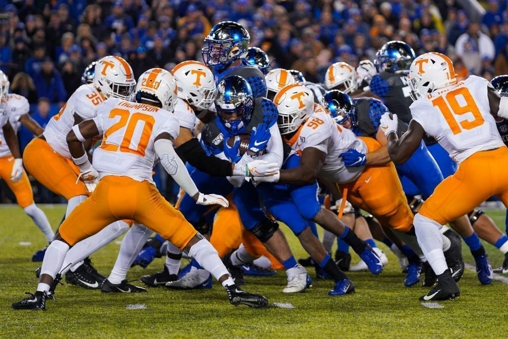 A Kentucky ball carrier gets gang tackled by Tennessee defenders when Tennessee played Kentucky in Kroger Field on November 9, 2019. Photo/ Ben Gleason