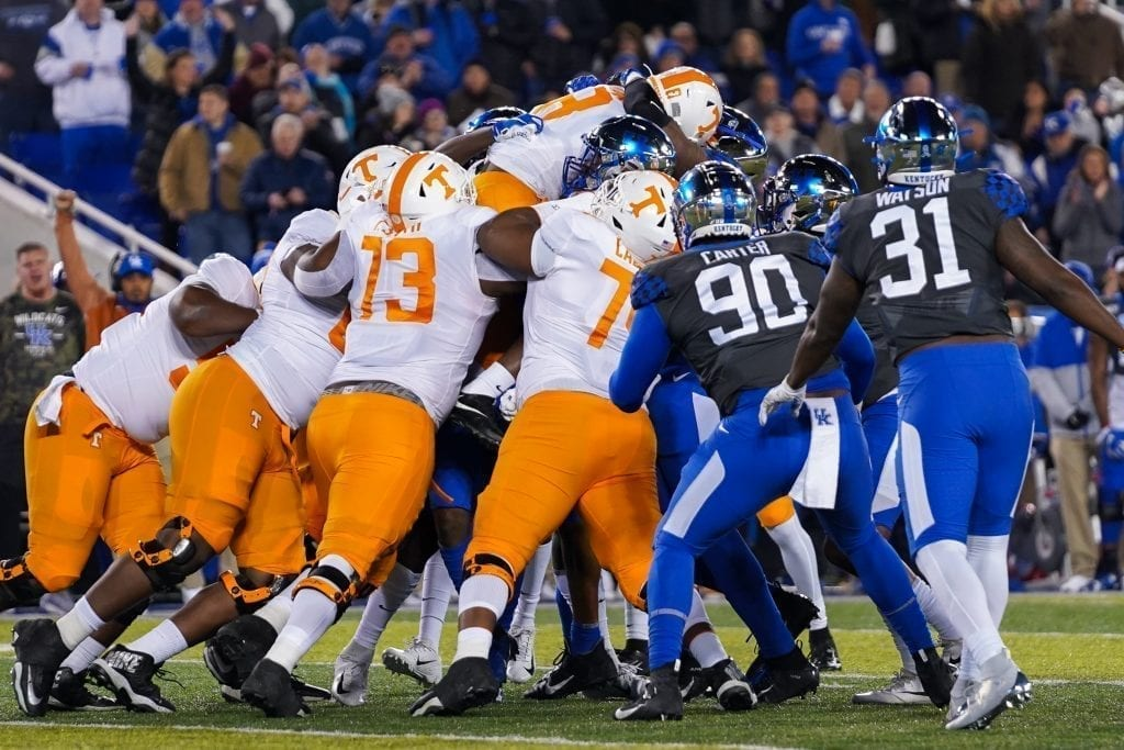 Tennessee offensive linemen lift up running back Ty Chandler (8) to gain extra yards when Tennessee played Kentucky in Kroger Field on November 9, 2019. Photo/ Ben Gleason