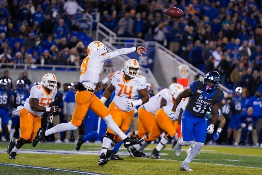 Tennessee quarterback Brian Maurer (18) leaps to make a pass when Tennessee played Kentucky in Kroger Field on November 9, 2019. Photo/ Ben Gleason