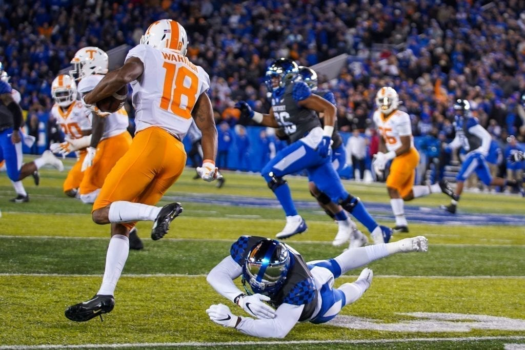 Tennessee defensive back Nigel Warrior (18) evades a Kentucky tackler when Tennessee played Kentucky in Kroger Field on November 9, 2019. Photo/ Ben Gleason