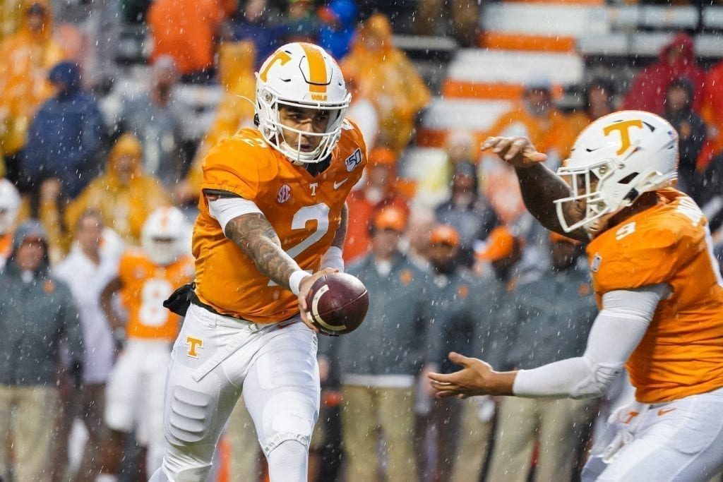 Tennessee quarterback Jarrett Guarantano (2) extends the ball to running back Tim Jordan (9) when Tennessee played Vanderbilt on Nov. 30, 2019. Photo/ Ben Gleason