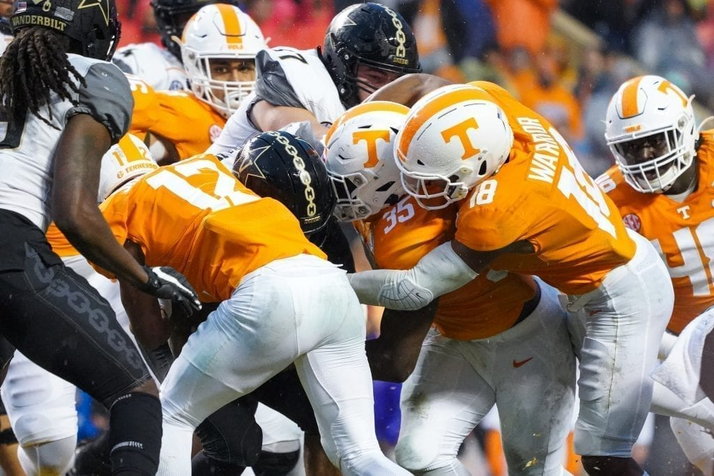 Tennessee defensive players gang tackle a Vanderbilt ball carrier when Tennessee played Vanderbilt on Nov. 30, 2019. Photo/ Ben Gleason