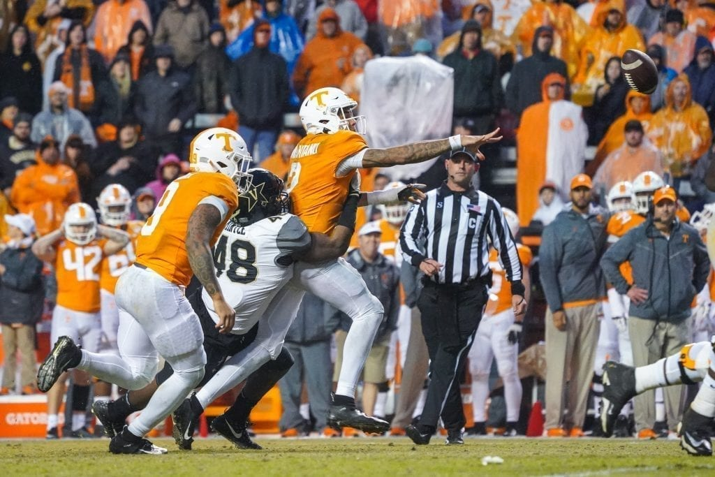 Tennessee quarterback Jarrett Guarantano (2) flips a pass forward when Tennessee played Vanderbilt on Nov. 30, 2019. Photo/ Ben Gleason