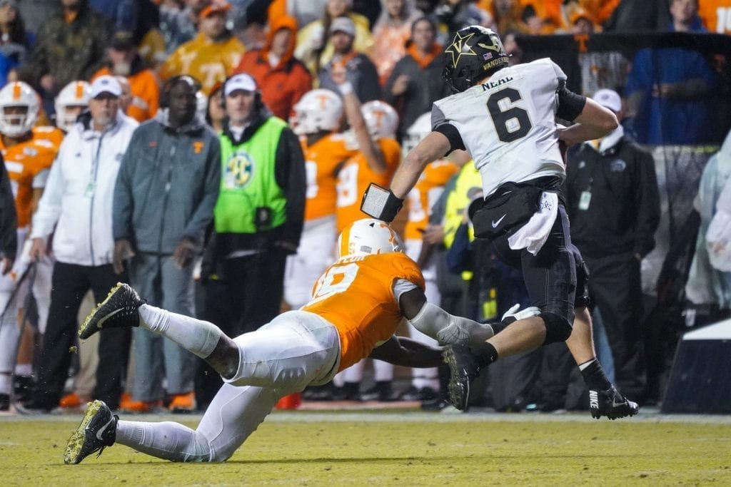 Tennessee line backer Darrell Taylor (19) dives for Vanderbilt quarterback Riley Neal (6) when Tennessee played Vanderbilt on Nov. 30, 2019. Photo/ Ben Gleason