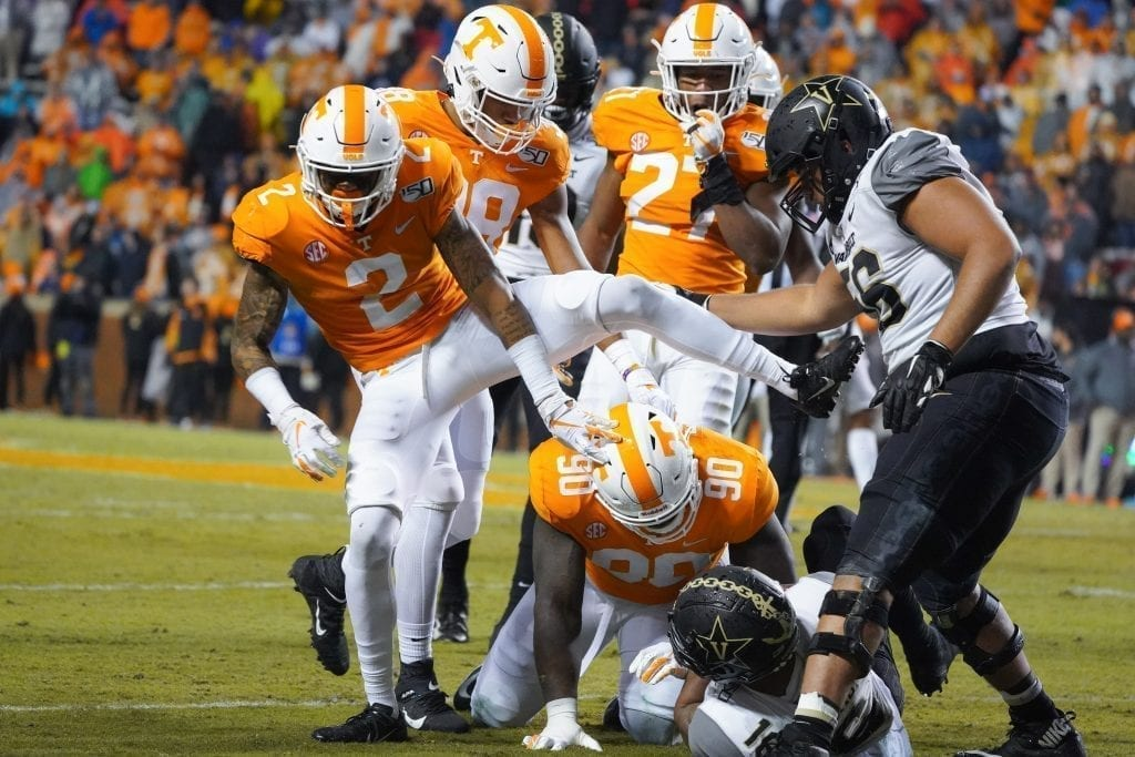 Tennessee cornerback Alontae Taylor (2) steps over players when Tennessee played Vanderbilt on Nov. 30, 2019. Photo/ Ben Gleason