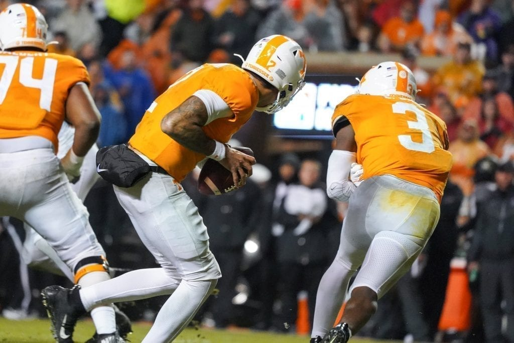 Tennessee quarterback Jarrett Guarantano (2) fakes the ball to running back Eric Gray (3) when Tennessee played Vanderbilt on Nov. 30, 2019. Photo/ Ben Gleason