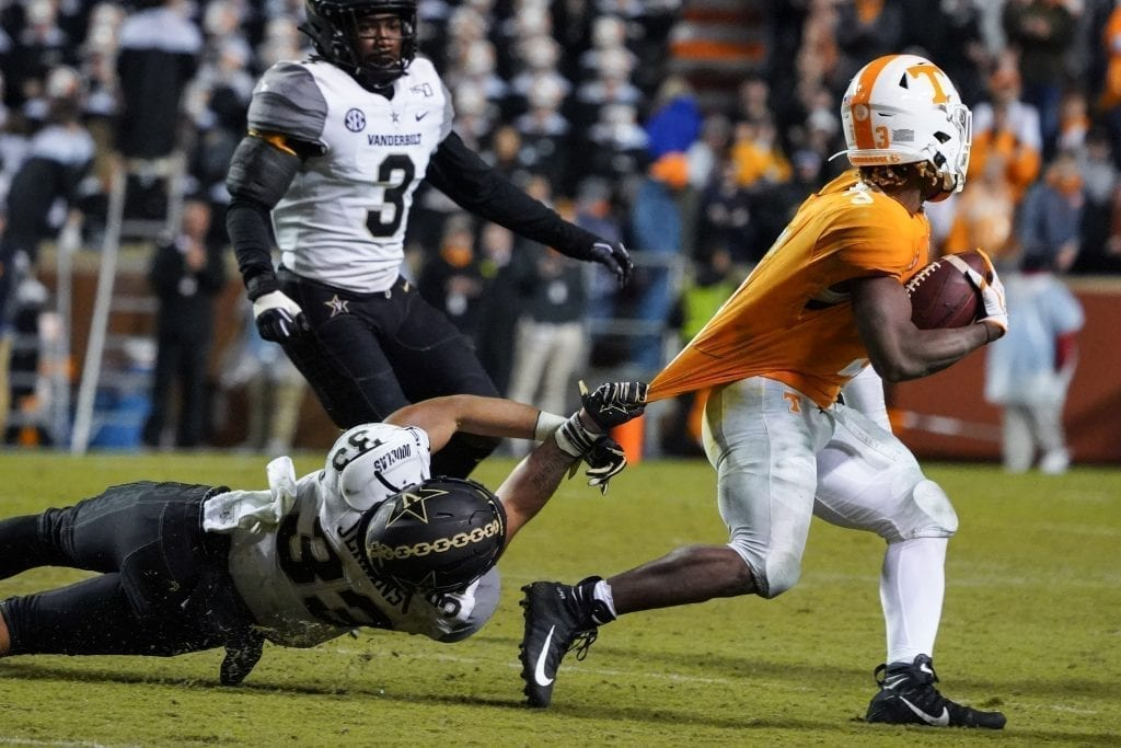 Tennessee running back Eric Gray (3) gets pulled down from behind by Vanderbilt defender Dashaun Jerkins (33) when Tennessee played Vanderbilt on Nov. 30, 2019. Photo/ Ben Gleason